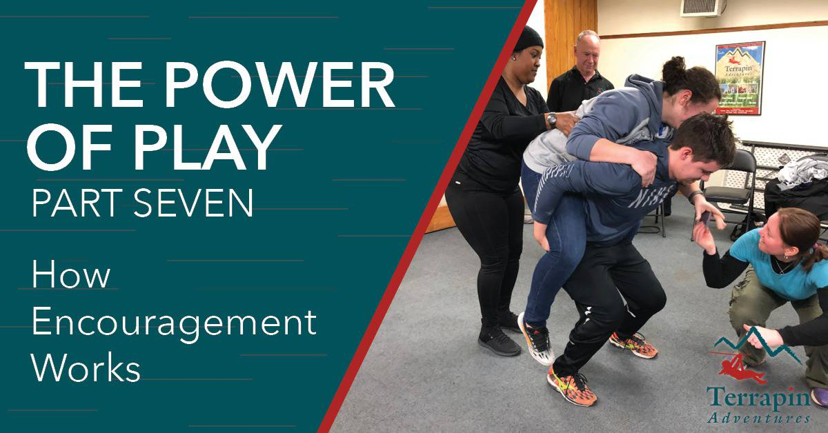 """Blog header reads """"The Power of Play Part Seven: How Encouragement Works."""" Pictured is a woman riding on a man's shoulders as two people assist."""