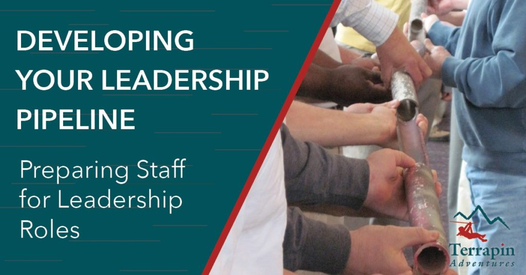 Text reads: Developing Your Leadership Piepline. Preparing Staff for Leadership Roles. The image shows a group of people holding pieces of pipe together in a row.